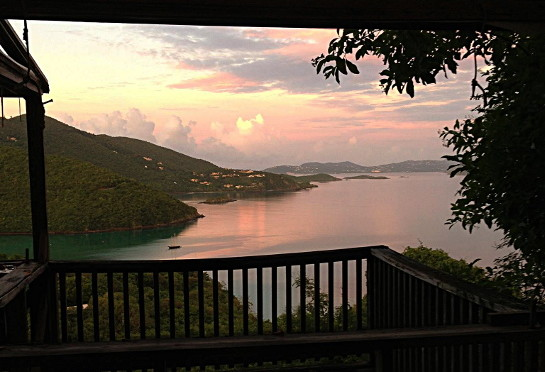 view of sunrise over St. John from a partially dismantled Maho Bay Camp tent.